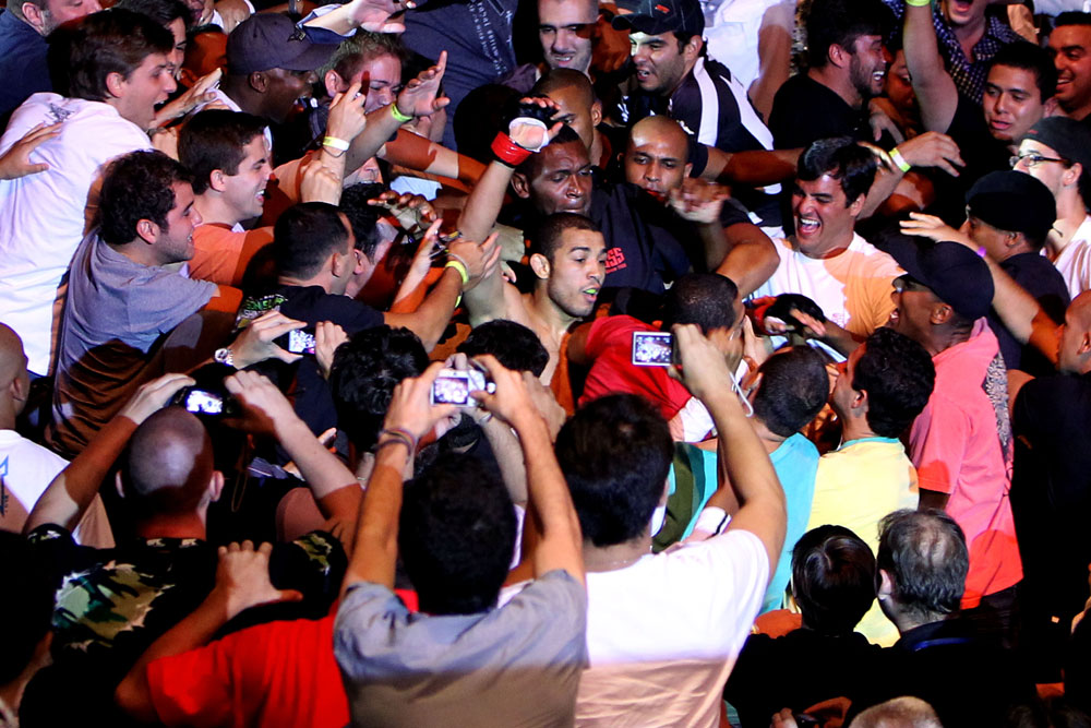 Featherweight champ Jose Aldo celebrates with his fans