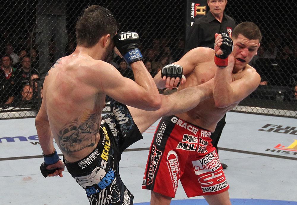 LAS VEGAS - FEBRUARY 04: Carlos Condit (left) kicks Nick Diaz during the UFC 143 event at Mandalay Bay Events Center on February 4, 2012 in Las Vegas, Nevada. (Photo by Nick Laham/Zuffa LLC/Zuffa LLC via Getty Images) *** Local Caption *** Carlos Condit; Nick Diaz